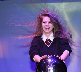 Anna from St Josephs College Cookstown trying out the Van de Graaff Generator