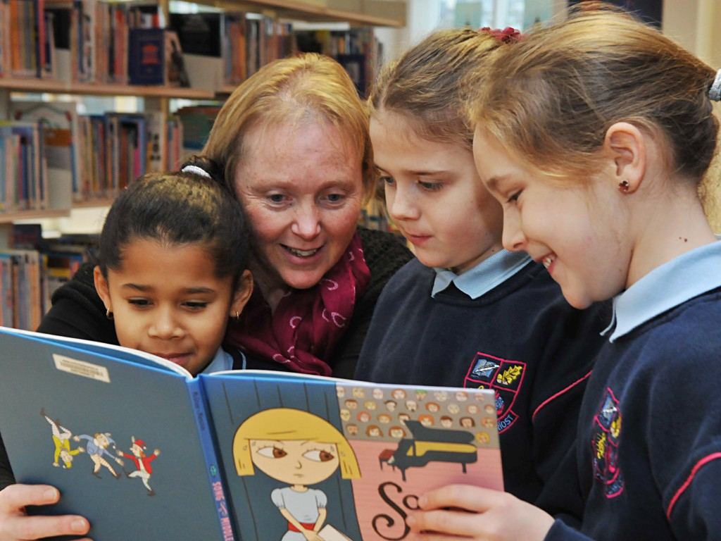 "No Reproduction Fee Finnola Browne, Bord Gais, with Sophie Gondo, Shanice Browne and Niamh Daly, pupils from Scoil Aiseiri Chriost Farranree at the ""Time to Read"" BITCI education programme in the Blackpool Library. Pic John Sheehan Photography"
