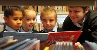 "No Reproduction Fee Seamus Gill, Bord Gais, with Sophie Gando, Ellie Leahy Greene and Katelyn Burns, Scoil Aiseiri Chriost Farranree, at the ""Time to Read"" BITCI education programme in the Blackpool Library. Pic John Sheehan Photography"